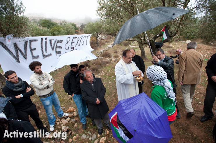 Palestinian Christians and solidarity activists gather for a Catholic mass to protest the Israeli separation wall that will cut off the Cremisan monastery and winery from nearby West Bank communities, November 18, 2011. (photo: Ryan Rodrick Beiler/Activestills.org)