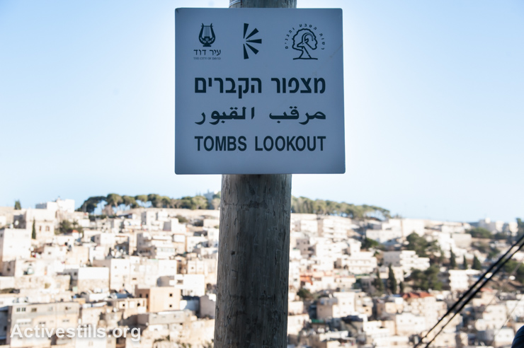 "A sign from tourist attraction, known as the ""City of David"", with a view of the Palestinian neighborhood of Silwan, East Jerusalem, December 16, 2013. The archaeological excavations and Israeli national park on the site are administered by the settler organization Elad. Though annexed by Israel, the international community considers East Jerusalem, including the Old City, to be occupied Palestinian territory."