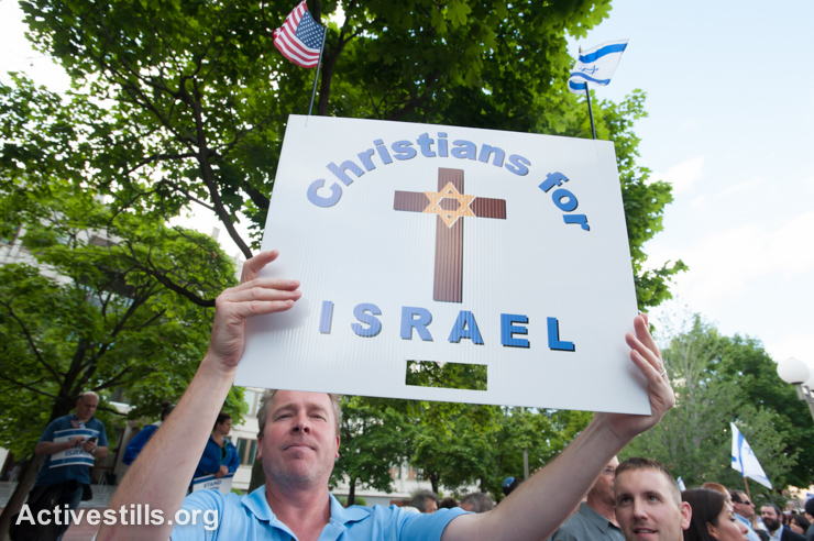 """A Zionist Christian attends a """"Stand with Israel"""" rally in Boston, August 7, 2014. The rally came in the midst of an Israeli military offensive that had thus far killed nearly 2,000 Palestinians, including at least 1,400 civilians. At the same time, three civilians in Israel and 64 soldiers had been killed by Palestinian militants."""