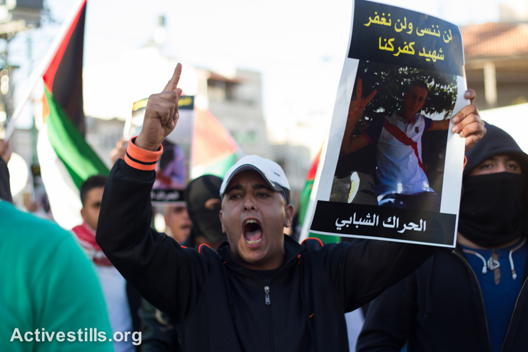 Palestinians with Israeli citizenship take part in a protest following the killing of Khayr al-Din al-Hamdan, in the town of Kfar Kanna, in the north of Israel, November 8, 2014. Clashes broke after police shot and killed of 22-year-old Khayr al-Din al-Hamdan, who was approaching a police car with a knife, during a police raid in the town the night before. (photo: Activestills.org)