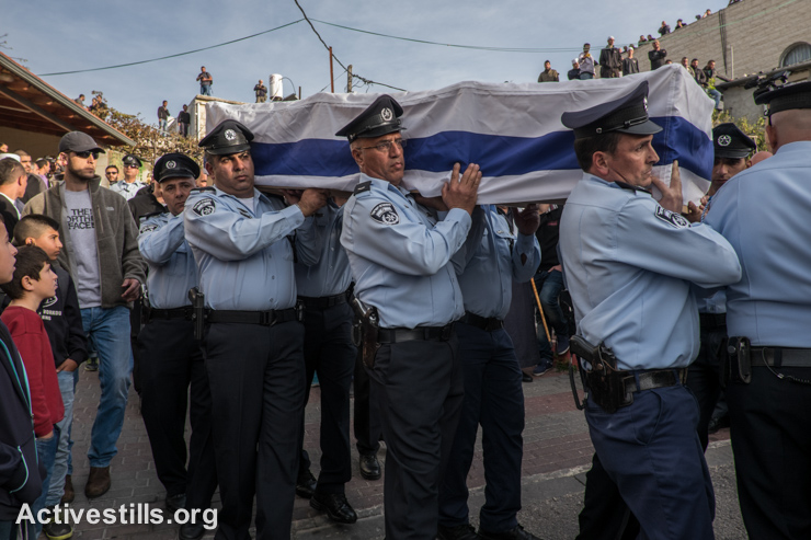 Policemen carry the body of the Druze Israeli police officer Zidan Sif during his funeral, in the village of Yanuh-Jat, Israel, November 19, 2014. Sif, 30, died in the hospital on November 18, after he was wounded in an attack by two Palestinians armed with meat cleavers and a gun who stormed a Jerusalem synagogue during morning prayers, killing four rabbis. (photo: Activestills.org)