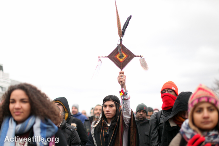 Native Americans gather for the National Day of Mourning rally in Plymouth, Massachusetts,  November 27, 2014. Every year since 1970, Native Americans and allies have gathered at noon on this day at Cole's Hill in Plymouth to commemorate a National Day of Mourning on the US Thanksgiving holiday. (photo: Activestills.org)