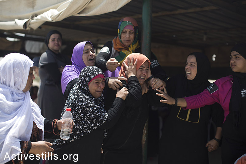 Bedouin women cry as they watch the demolition of their house during the demolition of the unrecognized Bedouin village of Al Araqib, in the Negev desert, June 12, 2014. Israeli authorities have demolished the village over 70 times since 2010. On June 12, for the first time, Israeli forces entered the village cemetery, demolishing its mosque and all the houses that local residents built after the first demolition in 2010. By: Oren Ziv/Activestills.org   Read more on Bedouin home demolitions and on Al Araqib.
