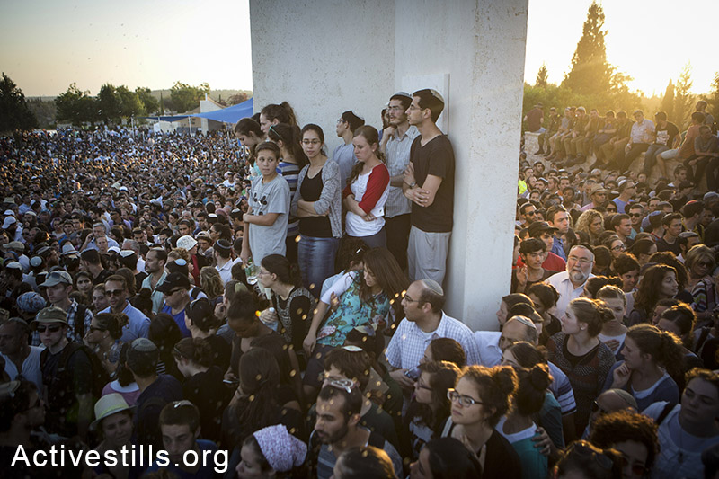 Family and friends of Eyal Yifrah, Gilad Shaar, and Naftali Fraenkel, three Israeli teenagers who were abducted over two weeks earlier, take part in their funeral in the city of Modi'in, Israel, Tuesday, July 1, 2014. Tens of thousands of mourners arrived to Modi'in in central Israel for a funeral service for three teenagers found dead in the West Bank after a two weeks of searches, raids and arrests in the West Bank, as Israel accused Hamas of abducting and killing the young men. Oren Ziv/Activestills.org   More on the kidnappings here.
