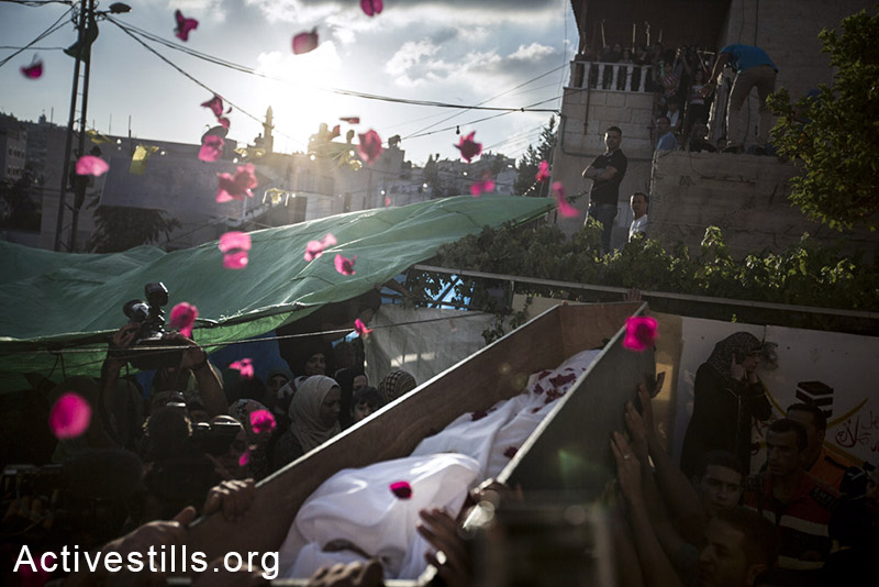 Palestinians carry the body of Mohammed Sinokrot during his funeral in the neighbourhood of Wadi Joz in East Jerusalem on September 8, 2014. Mohammed Sinokrot, 16, was wounded by police gunfire in the Wadi Joz neighborhood on August 31 and later died from his injuries on September 7. By: Faiz Abu-Rmeleh/Activestills.org   Read more on the case here and on the violence in East Jerusalem here.