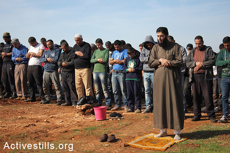 Palestinians perform Friday prayers on their agriculture land, Salem village, Nablus, West Bank, December 5, 2014. Photo by: Ahmad al-Bazz/Activestills.org