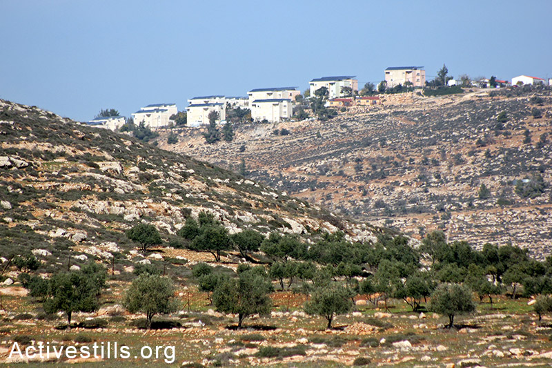Elon Moreh settlement seen from the agricultural lands of Salem village, Nablus, West Bank, December 5, 2014. Photo by: Ahmad al-Bazz/Activestills.org