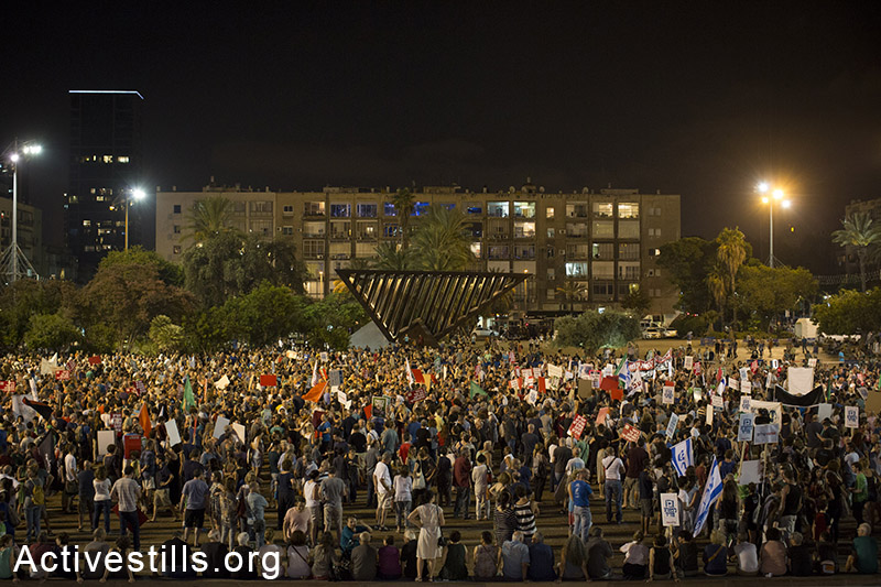 Israelis take part in a protest calling for peace negotiations between Israel and Palestinian, Tel Aviv,on August 16, 2014. Thousands of demonstrators gathered on Saturday for a pro-peace rally under the slogan: 'Changing Direction: Toward Peace, Away From War. By: Oren Ziv/Activestills.org   Read more on anti-war protests in Israel during the Gaza war here, and +972's Story of the Year: Gaza, here.