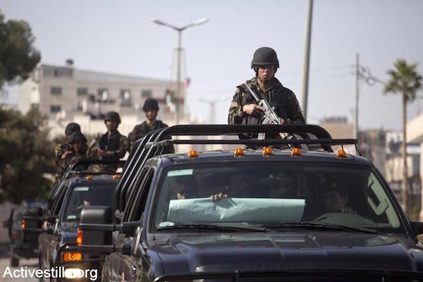 File photo of Palestinian security forces in the West Bank. (Photo by Activestills.org)