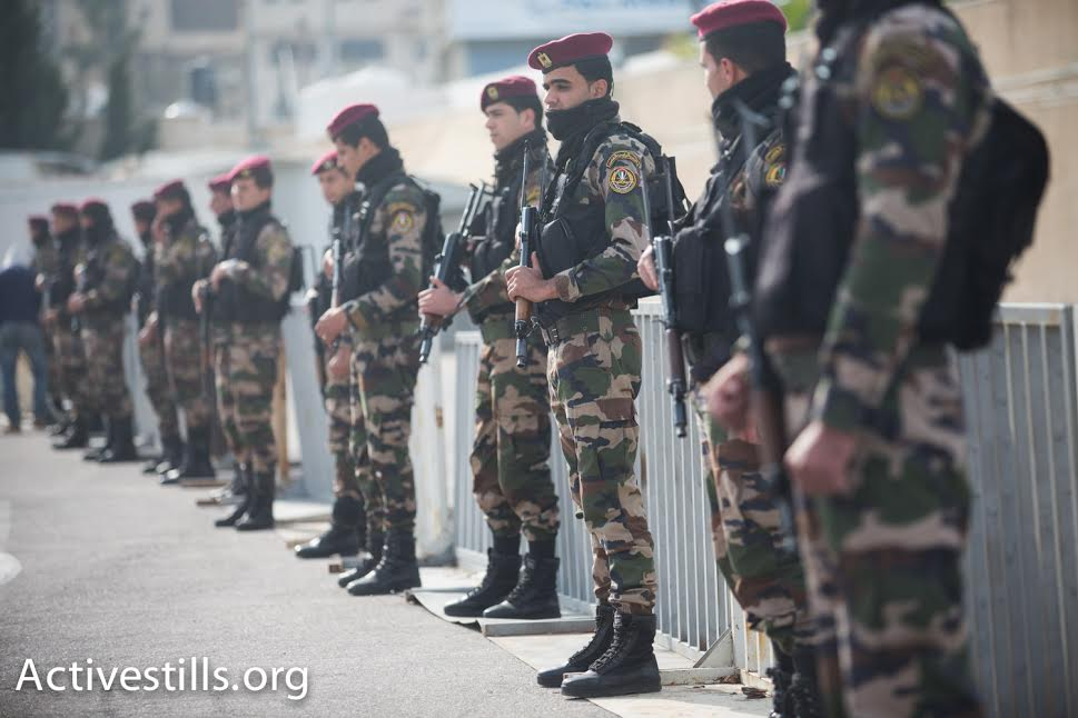 Members of Mahmoud Abbas' Presidential Guard look on during PA minister Ziad Abu Ein's funeral, Ramallah, December 11, 2014. (photo: Yotam Ronen/Activestills.org)
