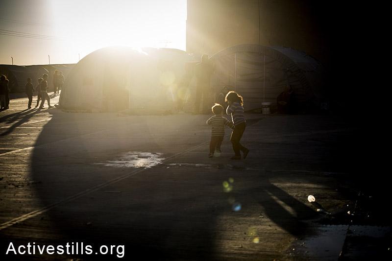 Children play at Ravaya refugee camp, on the border between Turkey and Syria, October 2014. Photo: Faiz Abu-Rmeleh/Activestills.org