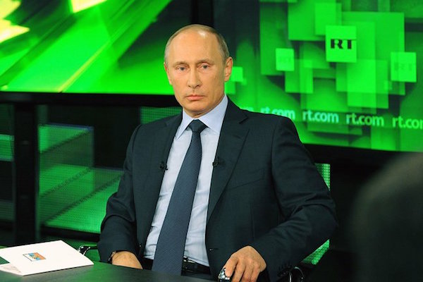 Russian President Vladimir Putin appears on state-owned television station Russia Today. (Photo by The Kremlin)
