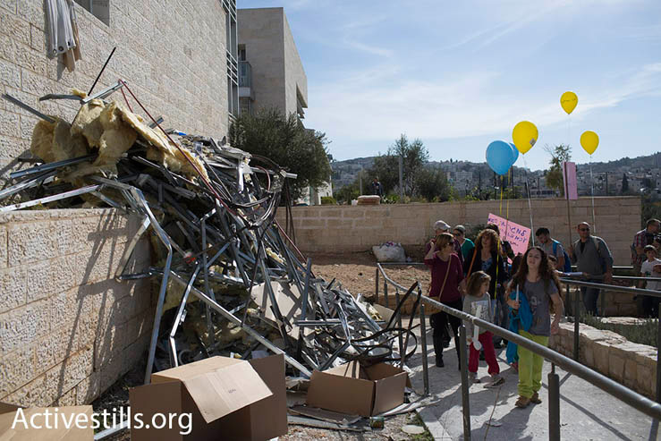"Marchers arrive at the Max Rayne ""Hand in Hand"" bilingual school, which was the target of a racist arson attack a week earlier, Jerusalem, December 5, 2014. (Photo by Oren Ziv/Activestills.org)"