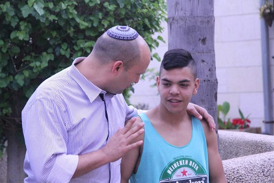 Naftali Bennett speaks to a young Israeli. (photo: Naftali Bennett's official Facebook page)