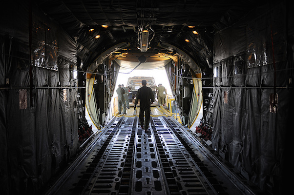 Israeli soldiers unload supplies from a C-130 cargo aircraft. (Photo: IDF Spokesperson)