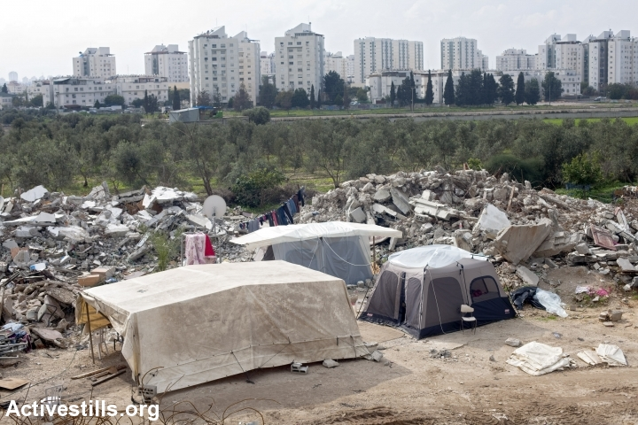 Palestinian family in Lod erects a tent where their home used to be, after it was demolished by Israeli authorities, September 2, 2011. (photo: Oren Ziv/Activestills.org)