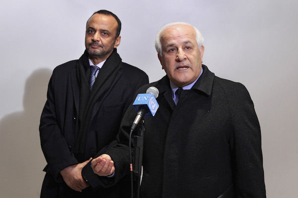 Riyad H. Mansour (right), Permanent Observer of the State of Palestine to the UN, speaks to journalists following a meeting of Arab delegations to the UN on a draft resolution regarding Palestinian statehood to be submitted to the Security Council, December 30, 2014. (UN Photo/Devra Berkowitz)