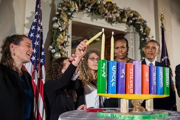 President Barack Obama, First Lady Michelle Obama, Rabbi Bradley Artson, and students from Hand in Hand participate in the Menorah lighting during Hanukkah reception #1 in the Grand Foyer of the White House, Dec. 17, 2014. (Official White House Photo by Pete Souza)