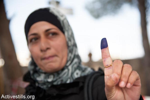 File photo of a Palestinian woman voting in Bethlehem. (Photo by Activestills.org)