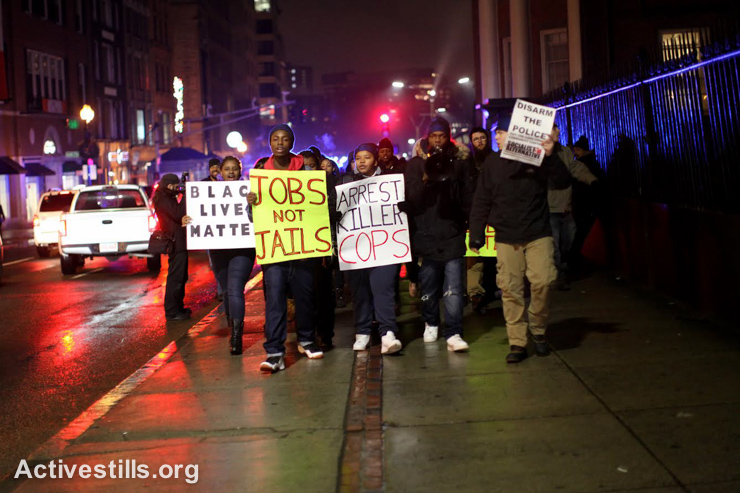 Youth march in downtown Boston, MA, on January 12, 2015. The march was organized as part of a series of actions responding to recent events in Ferguson, MO and around the USA of racial profiling and other mistreatment by police of people of colour. (photo: Activestills.org)