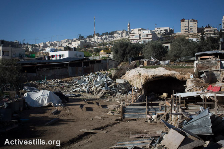 A demolished house in a Bedouin Jahalin community, E1 area, West Bank, January 14, 2015. Israeli authorities demolished houses and structures in the E1 as part of plan to displace the Bedouin community in the area by force. (photo: Activestills.org)