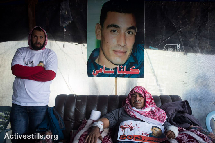 Khaled, the father of Sami al-Jaar, sits in a mourning tent before his son's funeral, Negev Desert, January 18, 2015. Sami al-Jaar, 22, was gunned down during a police drug raid in Rahat last week. Thousands participated in his funeral, chanting slogans protesting the police's use of force against Arab citizens of Israel. (photo: Activestills.org)