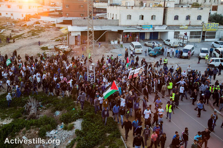 Bedouins take part in a march at the southern Bedouin city of Rahat, condemning the death of two residents of the town at the hands of the police, Negev Desert, January 20, 2015. The protesters marched from the house of al-Jaar family to Zayadna's house. Sami Zayadna was killed during clashes that erupted when a police car burst into the area where the funeral of Sami al-Jaar was held. Sami al-Jaar, 22, was gunned down during a police drug raid in Rahat the day before. Leaders of Arab citizens in Israel (1.7 million), declared a general strike in protest of recent events. (photo: Activestills.org)