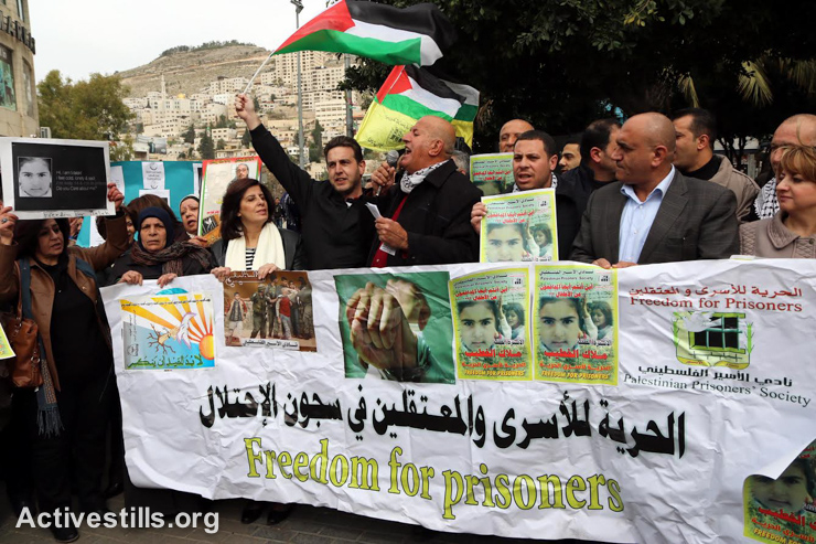 Palestinians protest in solidarity with Malak Khatib, a 14-year-old Palestinians girl, who is imprisoned in Israel, Nablus, West Bank, January 27, 2015. Al-Khatib, from Beiteen village near Ramallah, was taken prisoner on December 31, 2014, and was subjected to interrogation and harsh treatment without legal representation. On January 22, she was sentenced to two months in prison and her family was fined 6,000 shekels ($1,523). At the end of 2014, there were 197 children imprisoned by Israel. (photo: Activestills.org)