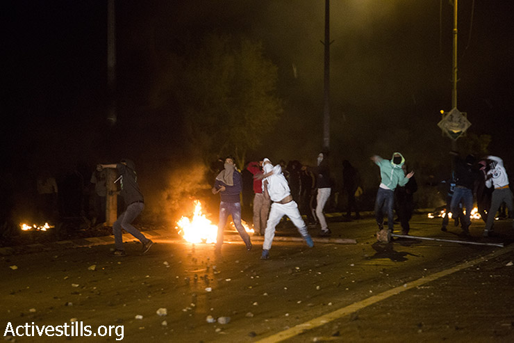 Clashes between Bedouin youth and Israeli police break out following the funeral of Sami Ziadna, who was killed during clashes that followed the funeral of another Bedouin man killed by Israeli police, January 20, 2015. (Photo by Activestills.org)