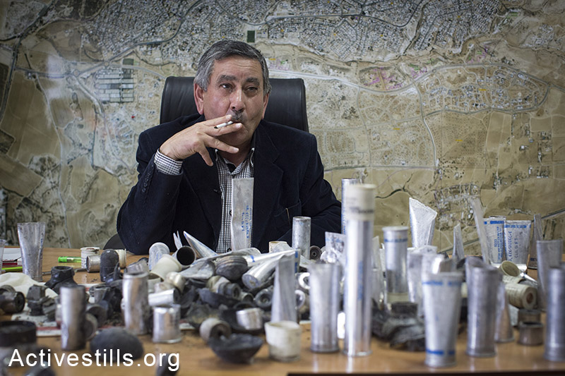 Talal Al-Krenawi, the mayor of the Bedouin town of Rahat, displays the ammunition used by the Israeli police during clashes yesterday, on January 19, 2015.  Sami Zayadna, 42, was killed during clashes that irrupted when a police car bursted into a closed area where the funeral of Sami al-Jaar was held the following day.  Sami al-Jaar, 22, was gunned down during a police drug raid in Rahat the day before. Activestills.org