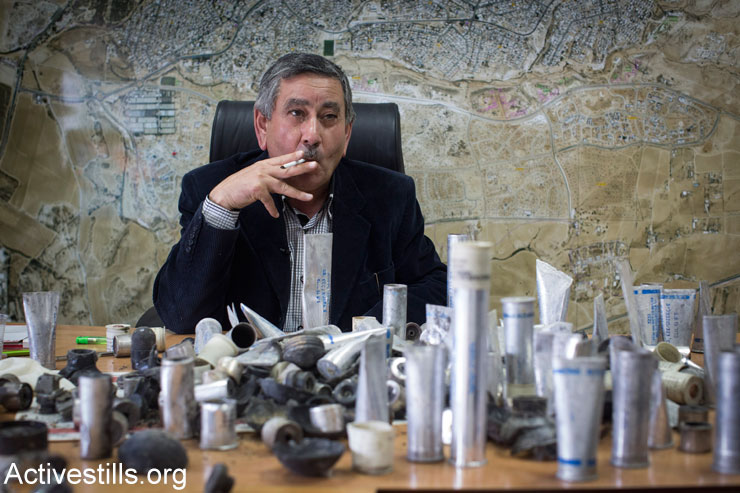 Talal Al-Krenawi, the mayor of Bedouin city of Rahat, displays ammunition used by the Israeli police during the clashes a day earlier at the funeral of Sami Ja'ar, who was killed during a police raid in the city, January 19, 2015. (Photo by Activestills.org)