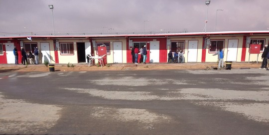 Asylum seekers exit their rooms at Holot Sunday morning, January 11, 2015.