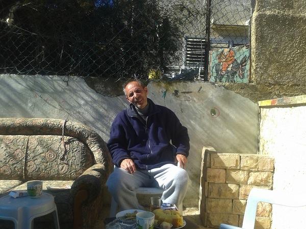 Salah Diab sits in his yard. (photo: Orly Noy)