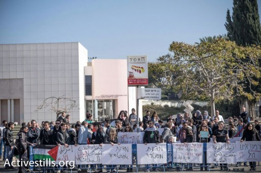 Palestinian citizens of Israel demonstrate at the entrance of Tel Aviv University against Israeli police violence toward Arab citizens, January 20, 2015. (Photo by Activestills.org)
