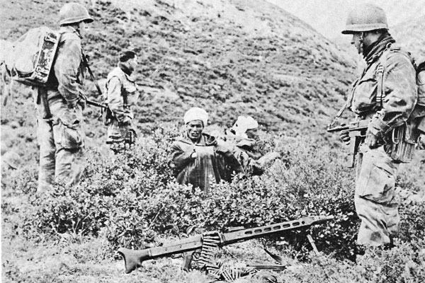 French soldiers capture FLN fighters in Algeria, 1958. (Author unknown)
