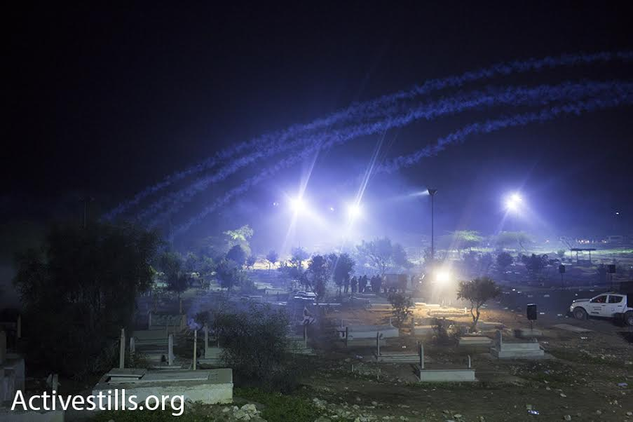 Tear gas clouds streak the sky during clashes between police and Bedouin in the city of Rahat. The clashes erupted in the wake of Sami Ja'ar's funeral, who was killed last week during a police operation in the city. (photo: Oren Ziv/Activestills.org)