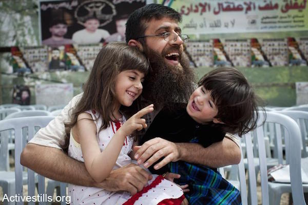 Khader Adnan plays with his daughters in the West Bank village of Araba, near Jenin on his first day after being freed from incarceration in an Israeli prison, April 18, 2012. (Photo by Oren Ziv/Activestills.org)