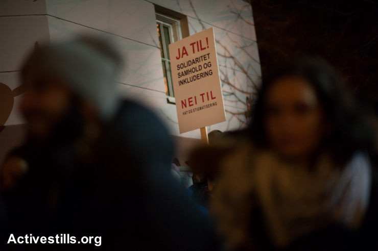 "A sign reads in Norwegian, ""Yes to solidarity, unity and inclusion; no to hatred and stigmatization"" among the more than 1,000 people gathered for the ""Ring of Peace"" vigil, February 21, 2015. The vigil was organized by Muslim youth in solidarity with Norway's Jewish community following anti-Jewish attacks in Denmark and other parts of Europe."