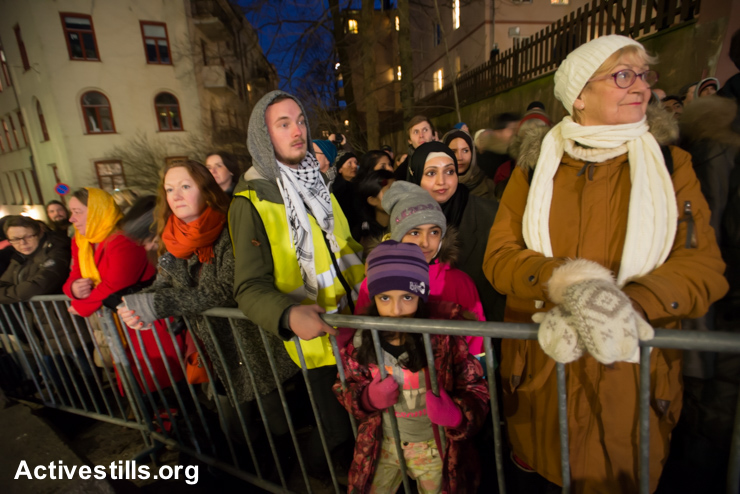 "More than 1,000 Norwegians of all faiths surround the Oslo Synagogue during the ""Ring of Peace"" vigil, February 21, 2015. The vigil was organized by Muslim youth in solidarity with Norway's Jewish community following anti-Jewish attacks in Denmark and other parts of Europe."
