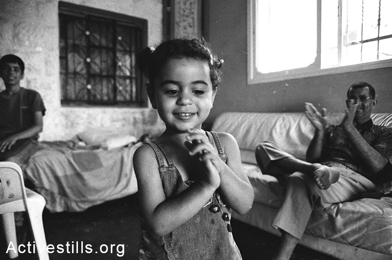 A child photographed during a personal visit in an off-protest day, Bil'in, West Bank, 2005. Keren Manor / Activestills.org