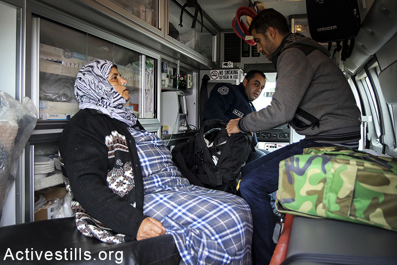 A Palestinian woman from the West Bank village of Azzun gets medical treatment after she suffocated from tear gas, during a protest for the opening of the eastern gate to the village, which has been closed by Israel since 1990, February 14, 2015. Ahmad al-Bazz / Activestills.org