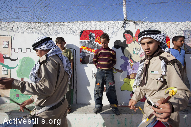 Youth marching at a funeral ceremony of Bassem Abu Rahme, Bil'in, West Bank, 2009. Shachaf Polakow / Activestills.org