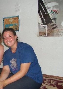 Kayla Mueller, sitting under a poster of Ashraf Abu Rahma from Bil'in. (Photo: ISM)