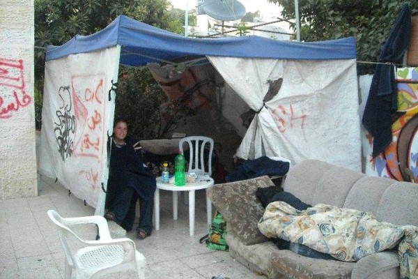 Kayla Mueller sitting in a protest tent in Sheikh Jarrah. (Photo courtesy of ISM)
