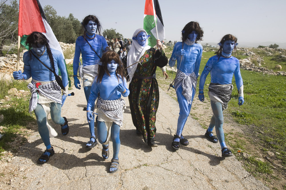 Palestinian and Israeli protesters dress up as characters from the film 'Avatar' during a demonstration against the wall in Bil'in. (photo: Oren Ziv/Activestills.org)