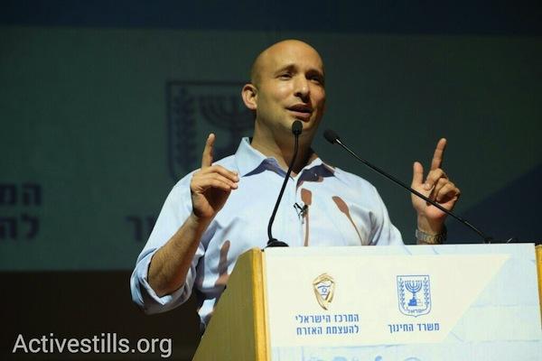 Naftali Bennett speaks at an event for high schoolers voting for the first time, Tel Aviv University, February 8, 2015. (photo: Yotam Ronen)