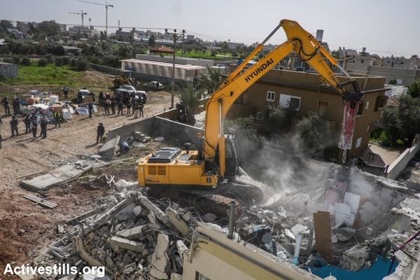 A bulldozer demolishes the home of Hana al-Nakib and her four children, in the city of Lod, February 10, 2015. (photo: Yotam Ronen/Activestills.org)