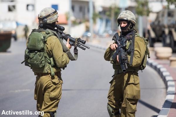 Illustrative photo of masked IDF soldiers. (Oren Ziv/Activestills.org)