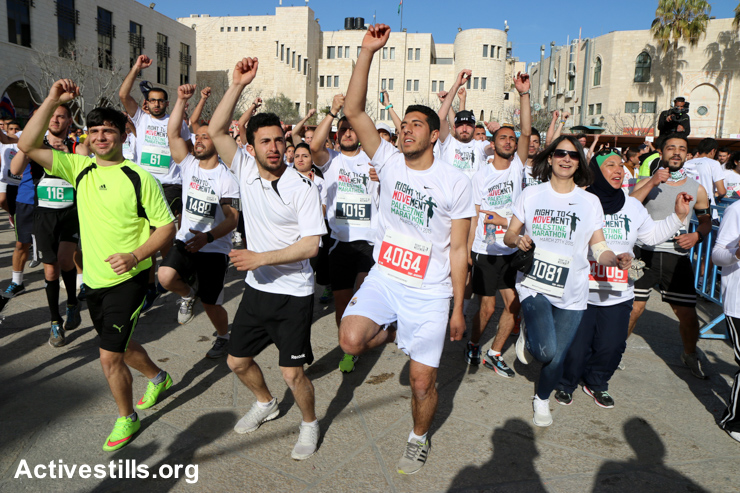 Participants warm up before the third annual Palestine Marathon, March 27, 2015.