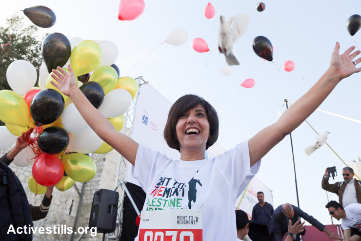 "A Palestinian participant releases a dove carrying a piece of paper that reads ""Back to Jaffa"" as a symbol of the right of return at the start of the third annual Palestine Marathon, March 27, 2015."